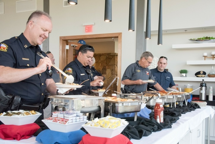 first responders enjoying breakfast at Canyon Falls community
