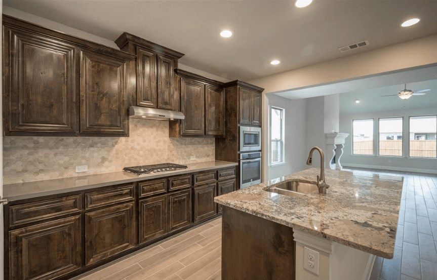 Ashton Woods Plan San Angelo Elevation kitchen 3 in Canyon Falls
