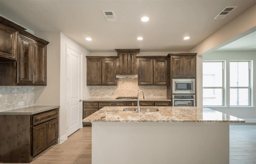 Ashton Woods Plan San Angelo Elevation Kitchen 5 in Canyon Falls