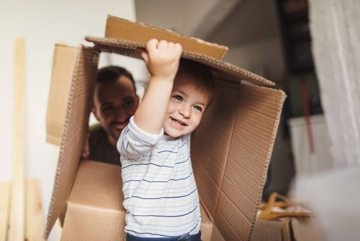 Happy little boy playing with a moving box | Canyon Falls, a new home community in Northlake, Flower Mound and Argyle, TX