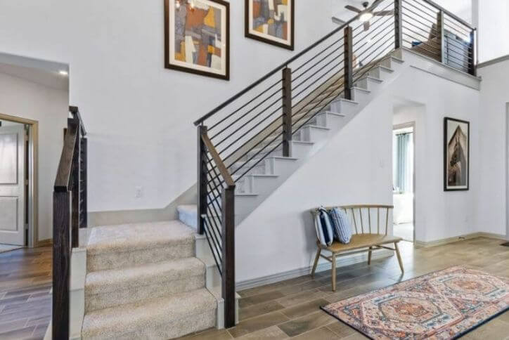 Landon Homes model home staircase at Canyon Falls community