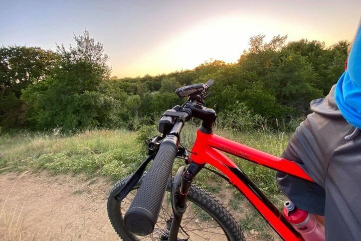 Close up of a red bike on Canyon Falls trails at sunset